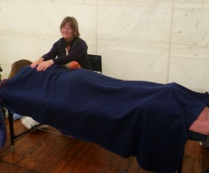 Reiki treatment in progress, in the Complementary Therapies Marquee at Traquair Fayre 2011